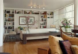 interior track lighting living room with white upholstery sofa