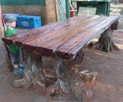With A Chainsaw I Make Rustic Log Furniture Table Using Tree Stumps For The Legs