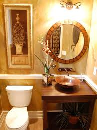 Guest Bathroom Wall Decor With Thin Framed Ornament Near Round Mirror Under Sconces