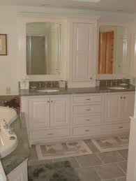 tower in center of bath vanity crystal cabinetry 2 tone bathroom
