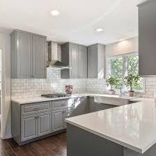 gray shaker cabinets white quartz counter tops grecian white