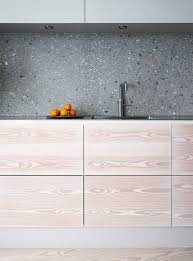 Grey Terrazzo Kitchen Backsplash Contrasts The Light Colored Cabinets