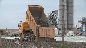 Dumper Truck Is Unloading Soil Or Sand At Construction Site Or Job ...