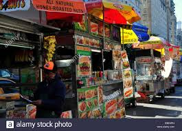 100 Food Trucks Nyc NYC A Row Of Food Trucks Covered With Umbrellas Lines The Sidewalk