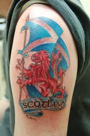 Colorful Scottish Flag With Lion Logo Tattoo On Shoulder
