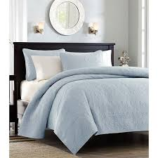 bed quilts sky iris