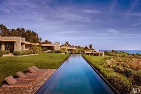 the 168 foot infinity pool is set in black granite tile and