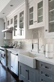 Grey white kitchen w dark wood floors Farmhouse sink