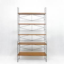 free standing shelves cabinet by nisse strinning for string design