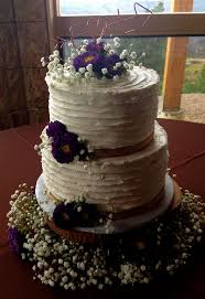 Rustic Style Wedding Cake With Babys Breath And Wildflowers