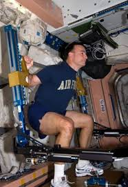 Astronaut Lee Archambault Commander Of The STS 119 Mission Conducts An Advanced Resistive