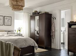 Brusali Wardrobe With 3 Doors by A Small Bedroom Furnished With A Wardrobe With Two Brown Doors And