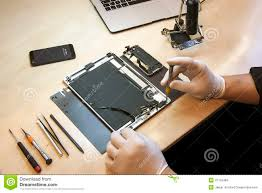 Apple IPhone And IPad Tablet Repairing Editorial Stock Image