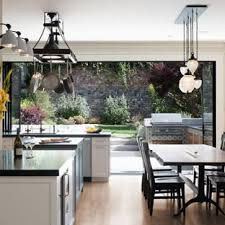 Example Of A Transitional Light Wood Floor And Beige Kitchen Dining Room Combo Design
