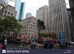 Rockefeller Plaza Christmas Tree Location by Wet Autumn View From West 50th Street Multi National Flags
