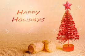 Happy Holiday Written In Red Artificial Christmas Tree With Champagne Cork On Bright Background