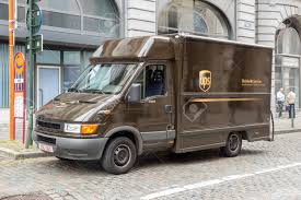 100 Ups Truck BRUSSELS JULY 30 2014 UPS Driver Delivers Packages Stock