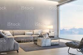 moderne luxus wohnzimmer mit blick auf das meer bei sonnenuntergang stockfoto und mehr bilder abenddämmerung