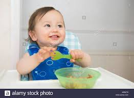 Baby Boy Eating Baby Food In Kitchen High Chair Stock Photo ... Baby Boy Eating Baby Food In Kitchen High Chair Stock Photo The First Years Disney Minnie Mouse Booster Seat Cosco High Chair Camo Realtree Camouflage Folding Compact Dinosaur Or Girl Car Seat Canopy Cover Dinosaur Comfecto Harness Travel For Toddler Feeding Eating Portable Easy With Adjustable Straps Shoulder Belt Holds Up Details About 3 In 1 Grey Tray Boy Girl New 1st Birthday Decorations Banner Crown And One Perfect Party Supplies Pack 13 Best Chairs Of 2019 Every Lifestyle Eight Month Old Crying His At Home Trend Sit Right Paisley Graco Duodiner Cover Siting