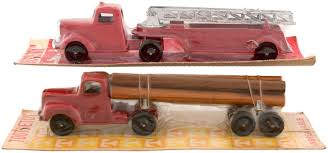 Hake's - TOOTSIETOY B MACK/L MACK LOG/FIRE TRUCK CARDED PAIR. Vintage Tootsie Toy Fire Trucks Country Tazures Toys Pickup Trucks Lot 9 Vtg 1970s Diecast Plastic Jeep Uhaul Panel Otsietoy Red Hook And Ladder Truck Facing Front Right Otsietoy Aerial With Extension 1940s Tootsietoy 236 Lofty Antique Water Tower 1920s 4 Color Version Hubley Ladders From The 1930s For Sale Pending Prewar Tootsietoys Article By Clint Seeley