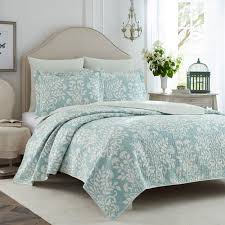 This blue floral quilt set includes two matching shams with a