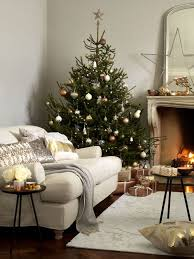 Copper Silver And Gold Ornaments Of Various Shapes Make The Tree Very Chic