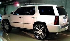 modified custom white Cadillac Escalade with Giovanna white 30