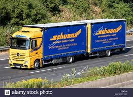 Schuon Truck On Motorway. Schuon Is A German Logistics Company With ... Uk To Test Driverless Trucks The Week In Ad 2025ad Mercedes Benz News Shows New Heavy Truck Germany British Army Bedford All Wheel Drive And East German Ifa W50 Trucks Volvo Fh 400 Euro 5 Truck Tractorhead Bas 135 Typ L3000s Wwii 100 Molds Modelling Apc Vector Ww 2 Series Stock Royalty Free Military Stands Under Roof Editorial Egypt Garbagollecting Of Amoun Project To Keep Khd S3000 Icm Holding Mariscos Beyer San Diego Food Roaming Hunger Krupp L3h163 Plastic Model Kits Old Military Stock Photo Image Of Antique 99180430