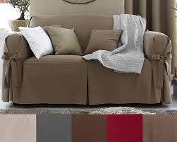housse de canapé cuir housses à nouettes pour fauteuil ou canapé becquet