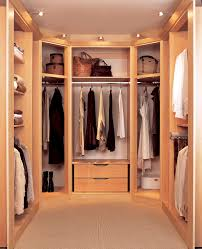 stylish small walk in closet with wooden shelves different