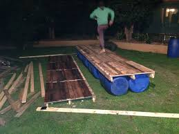 these guys built their very own pontoon raft using wood pallets