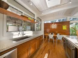 Architecture Charming Wooden Kitchen Island Mid Century Ranch Also Stainless Steel Sink Plus Modern Track Lighting And Refrigerator With Oven Beautiful