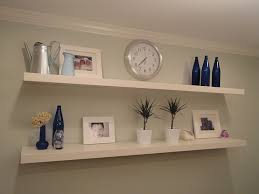 Simple White Panel For Appealing Floating Shelves IKEA With Various Ornaments On Grey Painted Wall