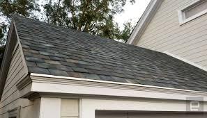 tesla has finally begun manufacturing solar roof tiles