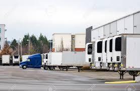 100 Semi Truck Trailers Big Rig Blue Semi Truck And Refrigerated Semi Trailers Standing