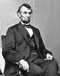 Abraham Lincoln President Of The United States Three Quarter Length Portrait Seated Facing Right