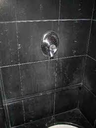 travertine shower with soap scum on it condo