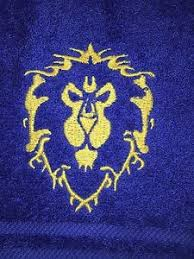 embroidered alliance lions crest royal blue bath towel and
