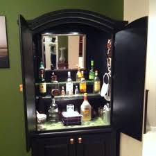 turn a old armoire into a bar for the home pinterest