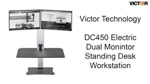 Dual Monitor Stand Up Desk by Victor Dc450 Electric Dual Monitor Standing Desk Workstation Youtube