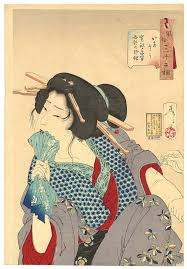 An 1888 Japanese Woodblock Print Of A Prostitute Biting Her Napkin In Pain As Arm Is Tattooed