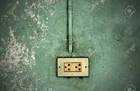 Electric Outlet In A Wall An Old House Interior Stock Photo