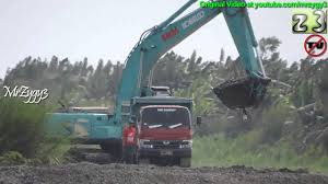 Excavator Kobelco SK200 Geospec Dredging Loading Dump Truck 130HT ... Single Axle Freightliner Dump Truck Youtube Bobcat A770 Loading Kids Video 1979 Ford F600 Truck New Video By Fun Academy On Trucks For Kenworth T880 Mack Granite Dump 1990 Gmc Topkick 100 Sold United Exchange Usa Inspiring Pictures Of A 21799 Lanl Debuts Hybrid Garbage My Ford F150 In The Mud Pulling Out A Stuck Euclid