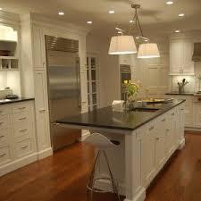 Black Marble Countertop Design With Kitchen Pendant Lighting By Hampton Bay Plus Wooden Flooring