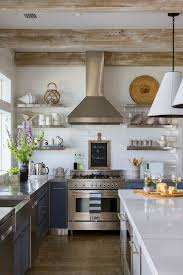 Rustic Kitchen With Two Toned Cabinets Perimeter Countertop Is Custom Stainless Steel Island