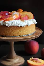 A Light And Elegant Olive Oil Honey Cake With Fresh Homemade Whipped Cream Sliced Peaches