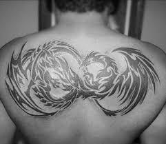 Upper Back Tribal Dragon Black Ink Tattoos For Guys