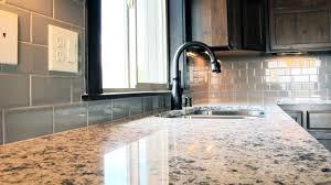 brown hexagon floor tile kitchen cabinet doors granite vs