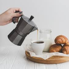 Crop Hand Pouring Coffee Into Cup Free Photo