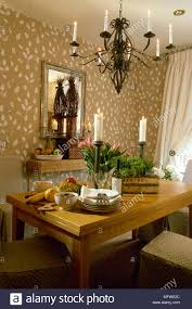 Dining Room With Pattern Wallpaper And Wood Table Beneath ...